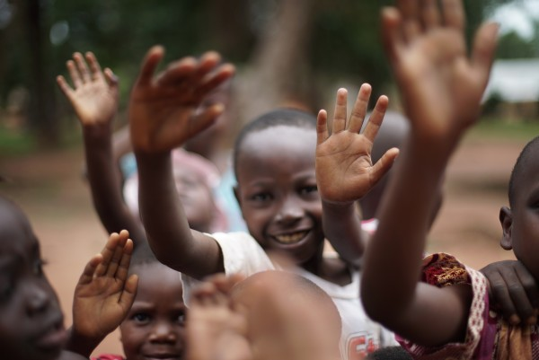 Kids waving in Congo