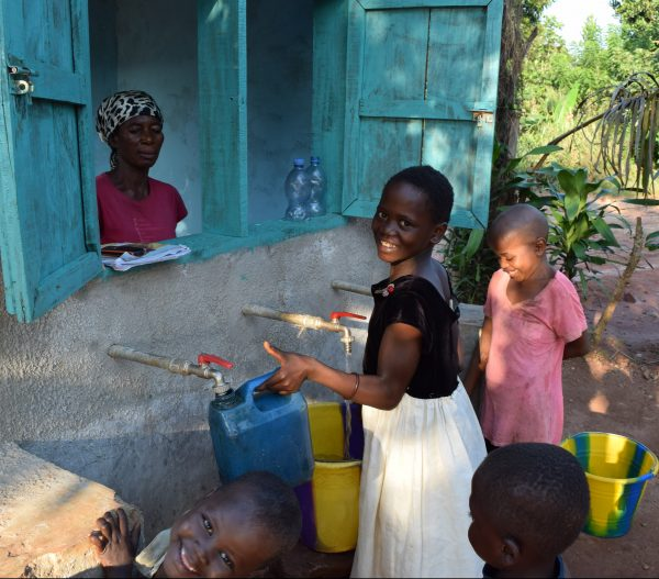 Merveille fills her jug with clean water