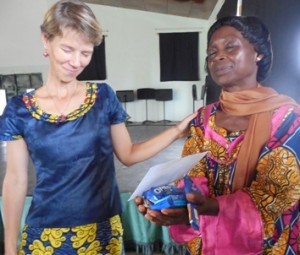 Mama Pauline with her friend Bianca, give thanks for the first gifts donated after chapel.