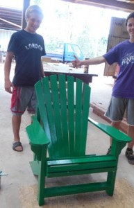 Ben's green chair is done - with a helping hand from Bob (right).