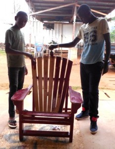 Donovan & Winner finish painting their chair red the last day of class.